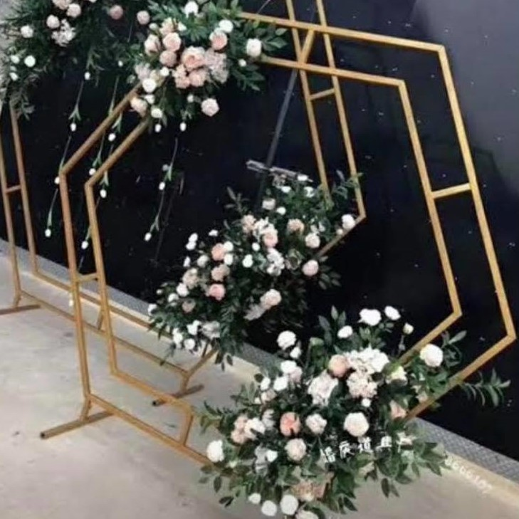 gold hexagone arbour styled with flowers