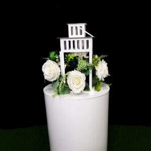 white lantern centrepiece with flowers